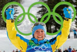 Charlotte Kalla tog Sveriges första guldmedalj i OS Vancouver.