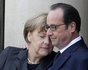 French President Francois Hollande embraces German Chancellor Angela Merkel.
