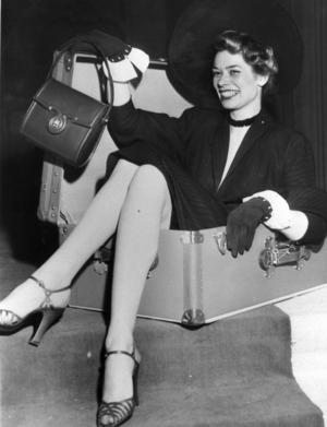 En snygg handväska och en snygg resväska, vad mer behövs för att resa med stil?