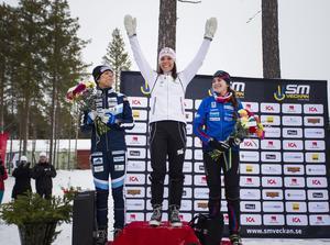 Charlotte Kalla vann, Maria Rydqvist, vänster, kom på andra plats och  Ebba Andersson, höger, kom på tredje plats i damernas skiathlon.