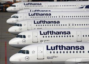 In this April 2, 2014 picture Lufthansa aircrafts are parked as Lufthansa pilots went on a three-days-strike in Frankfurt, Germany. Lufthansa says Thursday, July 30, 2015, that its earnings trebled in the second quarter compared with a year earlier, helped by falling fuel costs. (AP Photo/Michael Probst)