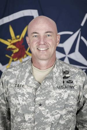 Brigadgeneral Frank Tate.