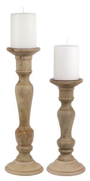 Höga träljusstakar från Lagerhaus. Passar till blockljus finns i två storlekar: 32 centimeter 149 kronor, 42 centimeter 199 kronor.
