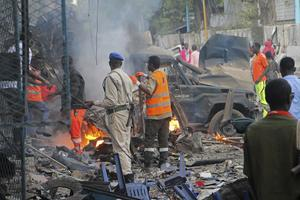 Somali soldier inspect wreckage of vehicles after a car bomb that was detonated in Mogadishu, Somalia Saturday, Oct 28, 2017. At least ten people were killed and several others wounded in the blast in Somalia's capital, police said.