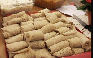 Injera – eritreansk pannkaka som ska avnjutas med kryddiga röror.