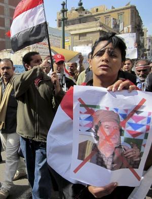 Brutal. Bilder från en demonstration i Egypten mot Libyens president Gaddafi i Egypten. Men i Libyen är det farligt att demonstrera.foto: Scanpix