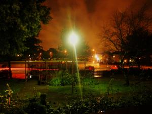 Provade natt-inställningarna på min digital kamera en augusti natt. Bilden är tagen ut genom mitt sovrums fönster i samma stund som en bil körde runt på parkeringen. Reslutatet blev en bild full av färger.