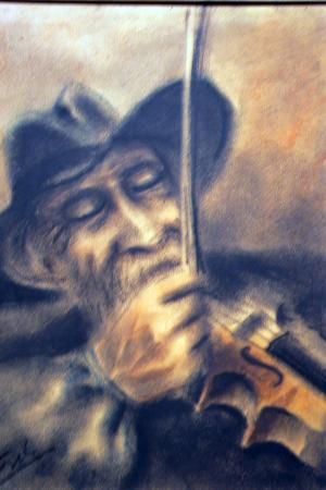 En speleman med hatt.