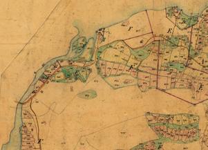 Detalj ur 1868 års Laga skifteskarta. Nu är det inte längre enbart samfälld mark utan holmarna och mark därikring tillhör manufakturverkets ägor.