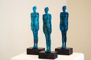 Bronsskulpturer med kopparpatina.