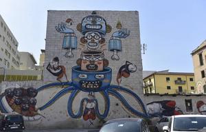 Väggmålning i centrala Palermo. Bläckfisken är en vanlig symbol för maffian.   Foto: Ola Wickander/TT
